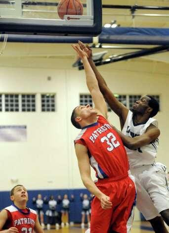 Mekeel's Marquan Newman goes to the basket for a score defended by Broadalbin-Perth's Chris Natoli during their boy's high school basketball game on Wednesday Jan. 27, 2015 in Scotia , N.Y. (Michael P. Farrell/Times Union) Photo: Michael P. Farrell / 00030367A