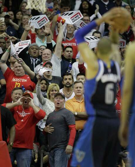 Rockets fans try to distract the Mavericks' Tyson Candler as he shoots two free throws after a flagrant foul on James Harden with 20.8 seconds remaining and Dallas trailing by three points. The harassment apparently worked, as Chandler missed both shots. Photo: Melissa Phillip, Staff / © 2014  Houston Chronicle