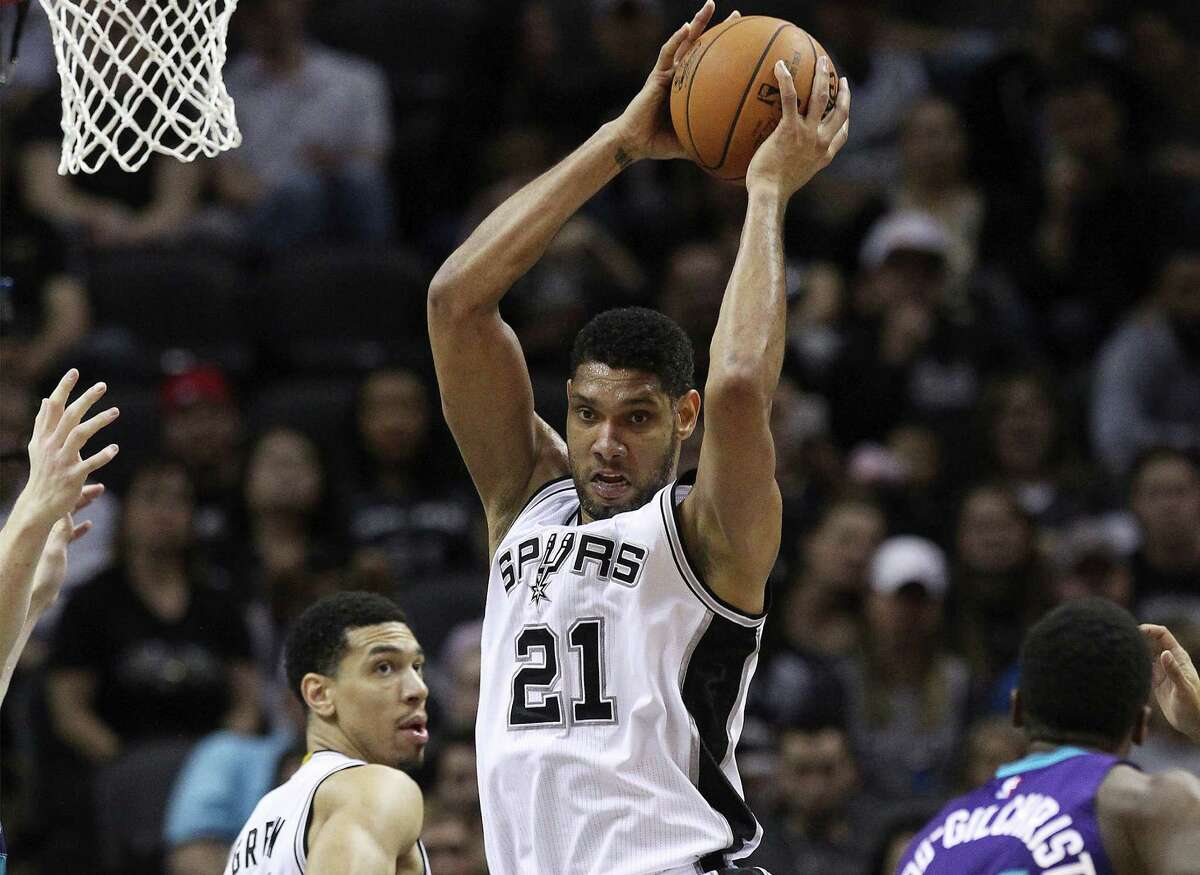 The Spurs' Tim Duncan grabs a rebound against the Charlotte Hornets at the AT&T Center on Jan. 28, 2015. The Spurs defeat the Hornets 95-86.