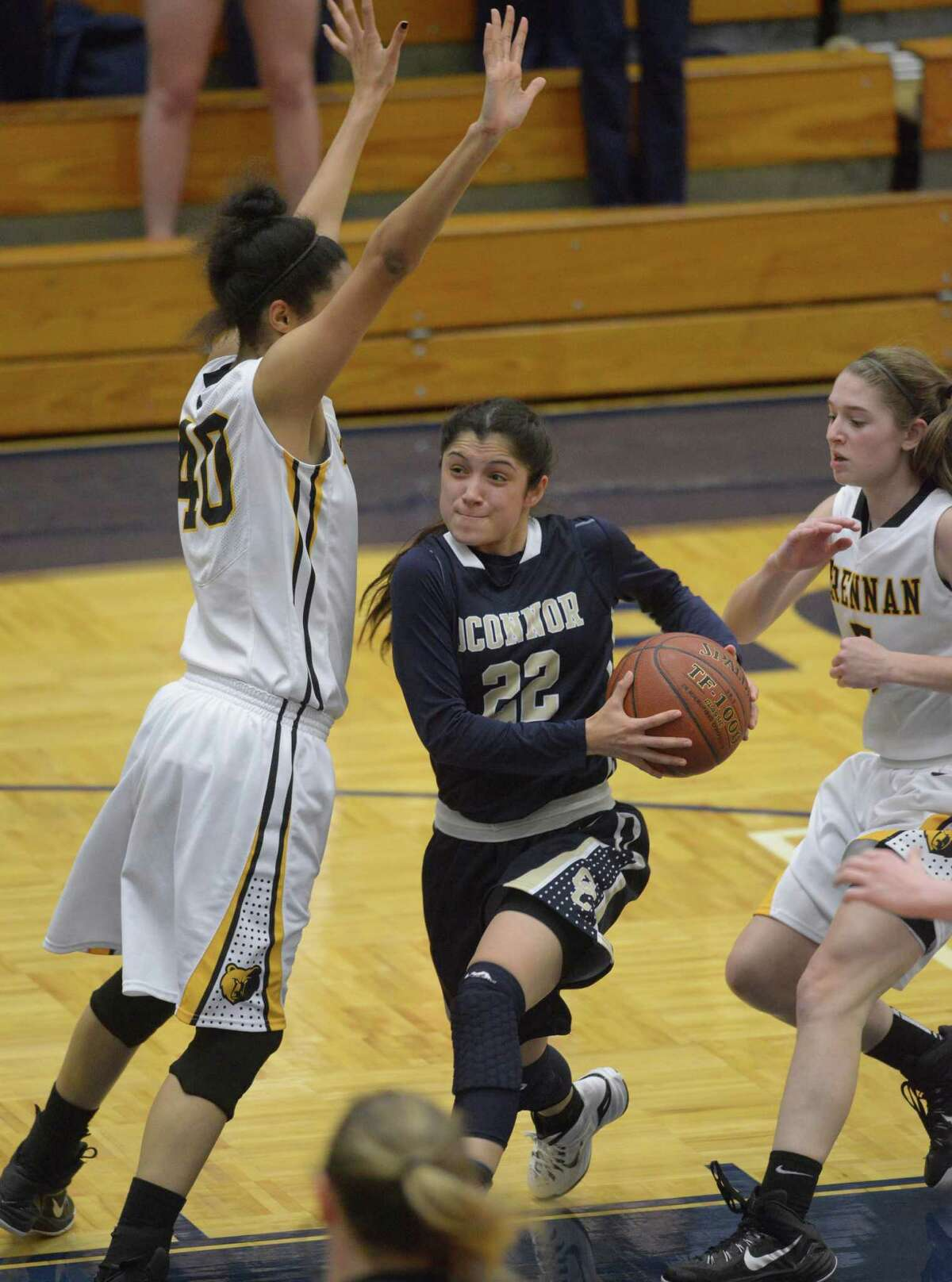 Amber Vidal of O'Connor drives between Monique Terry (left) and Kinzie Heineman (right) of Brennan.