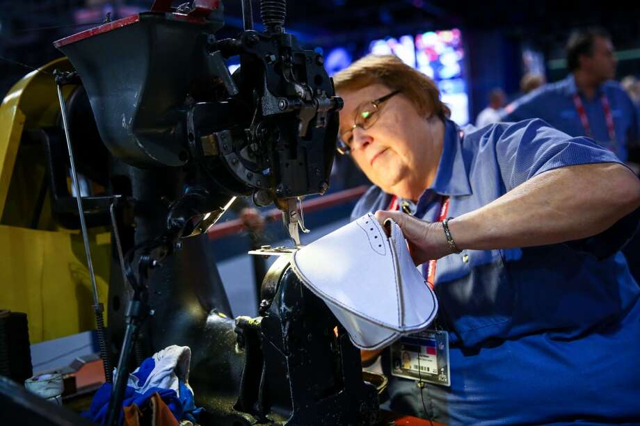 Iva Helser, who worked in the Wilson factory for 48 years, uses an industrial sewing machine to make a football during the NFL Experience on Wednesday, January 28, 2015 in downtown Phoenix. The event is a free, football-themed event for fans. One million visitors are expected to attend Super Bowl-related events in downtown Phoenix. Photo: JOSHUA TRUJILLO, SEATTLEPI.COM
