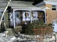 Police remained at the scene Thursday of a fire on Fairlawn Avenue that killed a woman and left her husband with smoke inhalation. Firefighters have not released the cause of the fire that began Wednesday evening at 156 Fairlawn Ave. (Bob Gardinier / Times Union)