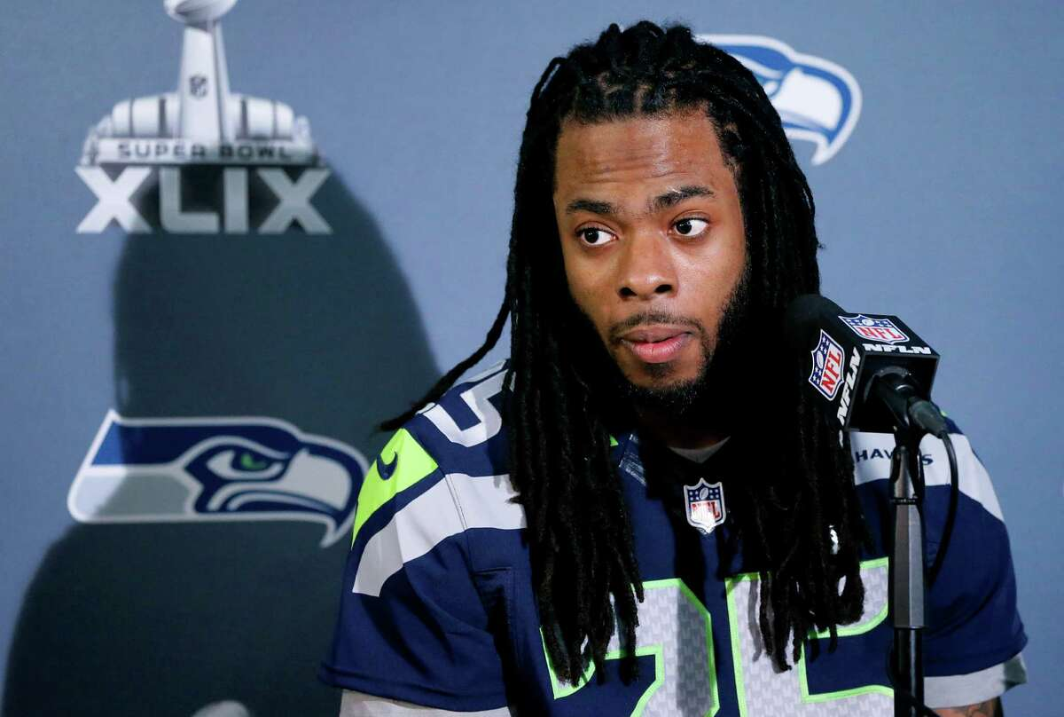 Seattle Seahawks cornerback Richard Sherman answers a question at a news conference for Super Bowl XLIX on Jan. 28, 2015, in Phoenix.