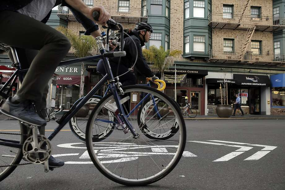 Bicyclists ride their bikes on Polk Street near California Street in San Francisco, Calif., on Wednesday, January 28, 2015. Polk Street improvements might make the narrow street tougher to negotiate as the improvements are designed to make this well traveled bike corridor safer. Photo: Carlos Avila Gonzalez, The Chronicle