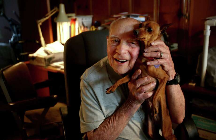 Bob Udell, 89, leads a quiet life with dog Troy (and cat Sassy) in Houston now, but he was an infantryman who helped defeat Nazism. Photo: Gary Coronado, Staff / © 2015 Houston Chronicle