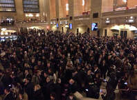 Commuters huddle in Grand Central Terminal on Wednesday evening, after a derailment in the tunnel forces cancelation and combining of some Metro North trains on the New Haven Line.