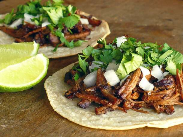 Tacos de Barbacoa   Like Chipotle's barbacoa but better. Set up a similar self-serve assembly line in your kitchen and let your guests make their own plates.  Click here for the recipe.