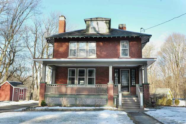 Dormers, deep porches buttressed with tapered piers or columns are markers of a Craftsman home, like this one, which also shows Prairie influence, at 31 Locust Ave., Troy, built in 1910.  (Paul Buckowski / Times Union) Photo: Paul Buckowski / 00030229A