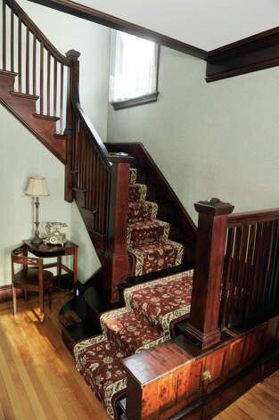 The Arts and Crafts staircase at 31 Locust Ave., Troy is typical of a Craftsman home. If you look closely, you can see the cabinet door at the bottom. The cabinet is big enough to store a vacuum cleaner.  (Paul Buckowski / Times Union) Photo: Paul Buckowski / 00030229A