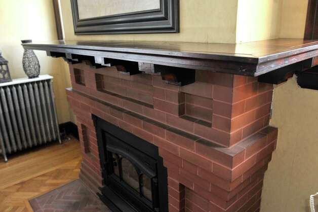 The DeBonises replaced the wood-burning portion of the fireplace at 31 Locust Ave., Troy,  with a custom gas insert without cutting the original hearth.  (Paul Buckowski / Times Union) Photo: Paul Buckowski / 00030229A