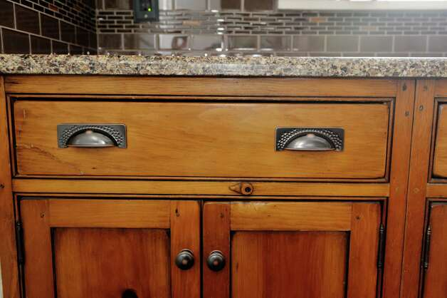 A view of the wooden kitchen drawers and cabinets inside the home located at 31 Locust Ave., on Tuesday, Jan. 20, 2015, in Troy, N.Y.   (Paul Buckowski / Times Union) Photo: Paul Buckowski / 00030229A