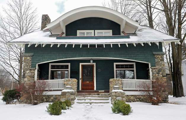 Front gables are typical for a Craftsman, the one at 172 Circular St., Saratoga Springs is unique because of its curved style.  (Lori Van Buren / Times Union) Photo: Lori Van Buren / 00030328B
