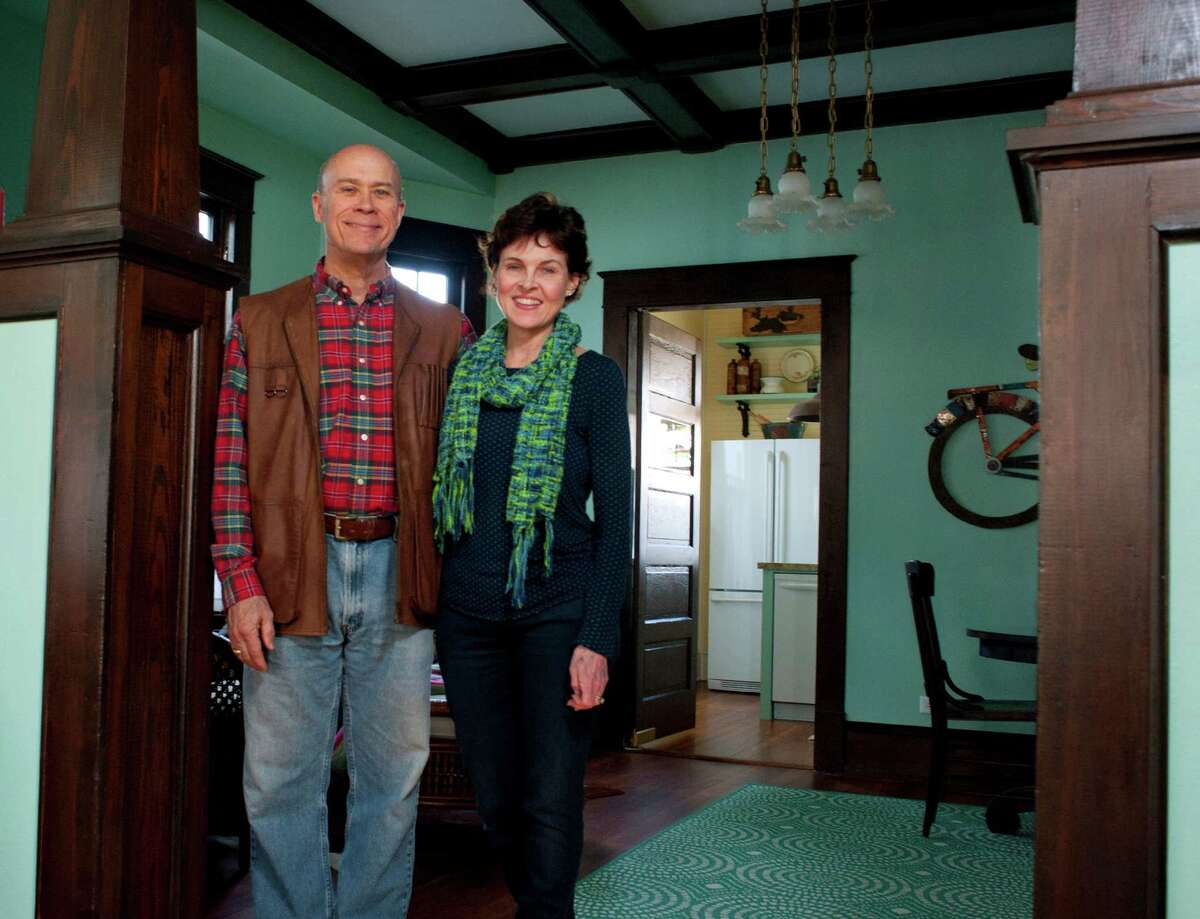 David Douglas and Lamar Mathews pose for a photo inside the 1914 house they recently restored in Galveston, Texas' Kempner Park neighborhood on Saturday, Jan. 17. The couple restored the house with original floors, woodwork and fixtures in about a year.