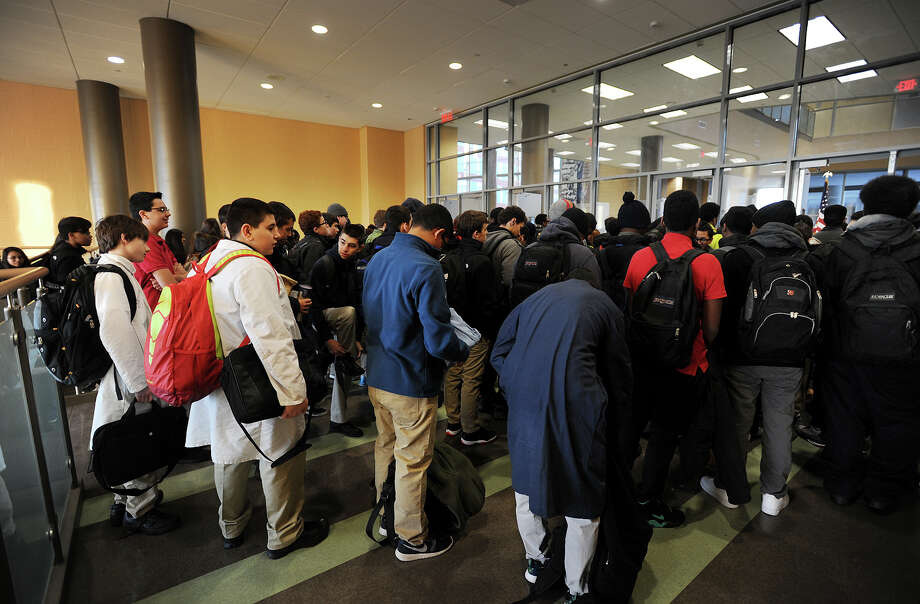Hundreds of students wait to have their backpacks searched and pass through metal detectors at the start of the school day at the Fairchild Wheeler Interdistrict Magnet School in Bridgeport, Conn. on Thursday, January 29, 2015. Photo: Brian A. Pounds / Connecticut Post
