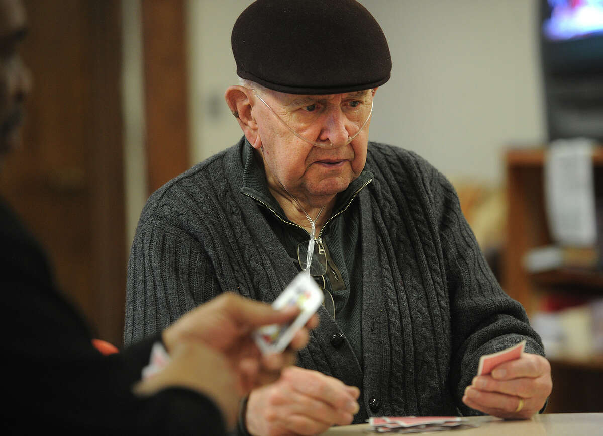 Ray Madar, of Stratford, enjoys a spirited game of pinochle at The Baldwin Senior Center in Stratford, Conn. on Thursday, January 29, 2015.