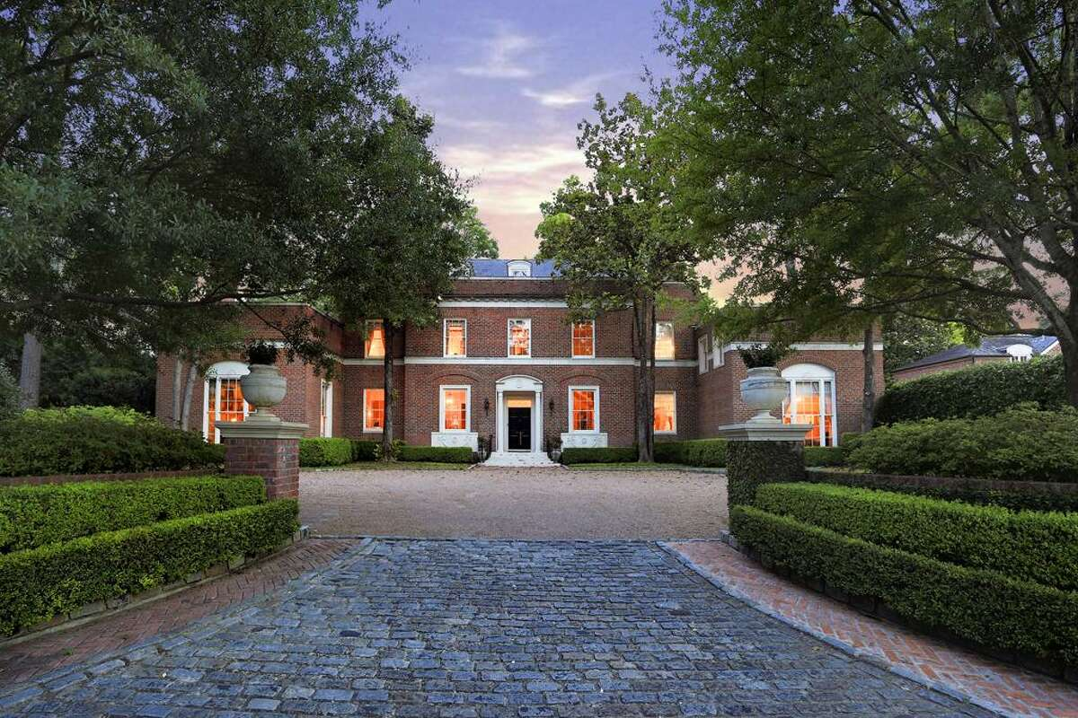 7 Winston Woods: This Georgia-style estate features original finishes, 7 bedrooms, 5 fireplaces and lush green outdoor space in the Memorial area.