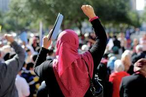 Participants cheer during a Texas Muslim Capitol Day rally, Thursday, Jan. 29, 2015, in Austin, Texas. Hundreds of Muslims are rallying as part of their biennial Texas Capitol lobbying day, but a small group of counter-protesters are trying to shout them down. (AP Photo/Eric Gay)