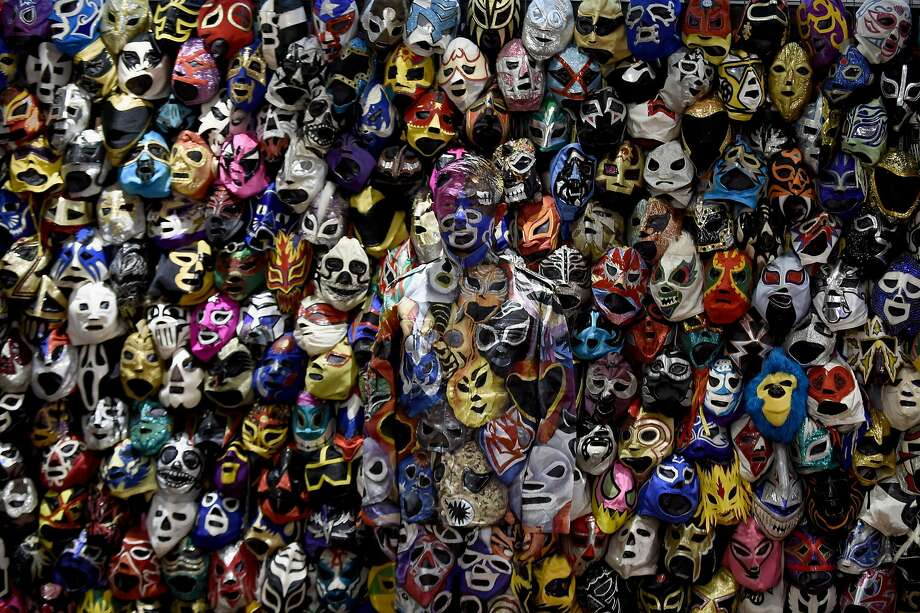 HINT, HE LOOKS A LITTLE BLUE:Can you find Chinese performance artist Liu Bolin standing among dozens of masks in the lobby of the Presidente Intercontinental Hotel in Mexico City? Photo: Alfredo Estrella, AFP / Getty Images