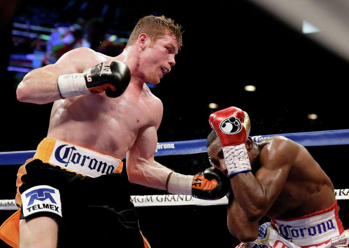 Canelo Alvarez hits Erislandy Lara during their super welterweight fight on July 12, 2014, in Las Vegas.