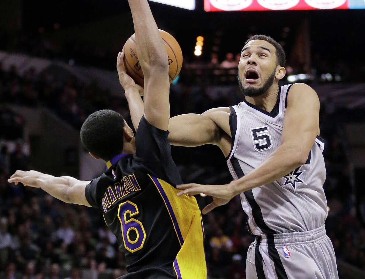 Spurs guard Cory Joseph is fouled by the Los Angeles Lakers' Jordan Clarkson as he tries to score during the second half on Jan. 23, 2015, in San Antonio.