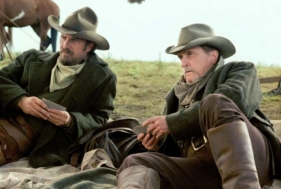 As cattlemen Boss Spearman (Robert Duvall, right) and Charley Waite (Kevin Costner, left), a tortured former Confederate sharpshooter, drive their herd cross country, living by the law of the open range, a belief that land, grass and water are open to all, they stop to gather supplies in a small Montana town, where they are confronted by a corrupt land baron who hates free-rangers and has his eye on stealing the herd and doing away with the cattlemen by any means necessary.  The Hallmark Channel Premiere of Open Range is Saturday, July 14 (9/8c). Photo: Buena Vista Television. / Hallmark Channel