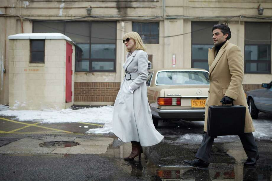 "This photo released by courtesy of A24 shows, Jessica Chastain , left, and Oscar Isaac, in a scene from J.C. Chandor's ""A Most Violent Year."" (AP Photo/A24, Atsushi Nishijima) ORG XMIT: CAET242 Photo: Atsushi Nishijima / A24"