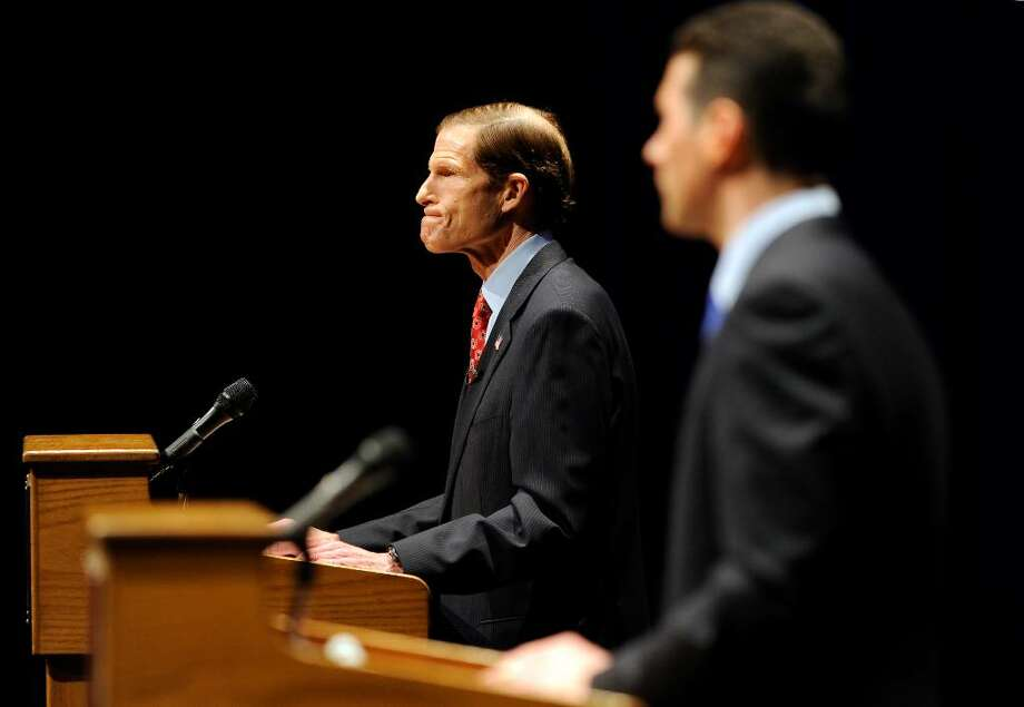 West Hartford, CT  3/1/10   Attorney General Richard Blumenthal (L) shows his frustration with a response from businessman Merrick Alpert, (R) during their debate at the Lincoln Theater on the University of Hartford campus in West Hartford, Conn., Monday, March 1, 2010.  Photo by JOHN WOIKE | woike@courant.com ORG XMIT: CTHAR101 Photo: John Woike, Hartford Courant / \20100301\10014002A