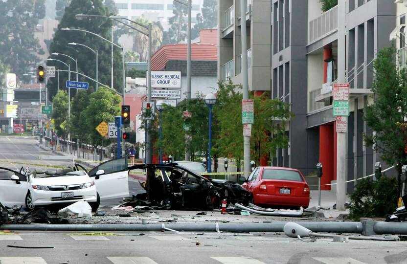 In this photo taken July 4, 2014, a Hollywood street is closed at an accident scene during an invest
