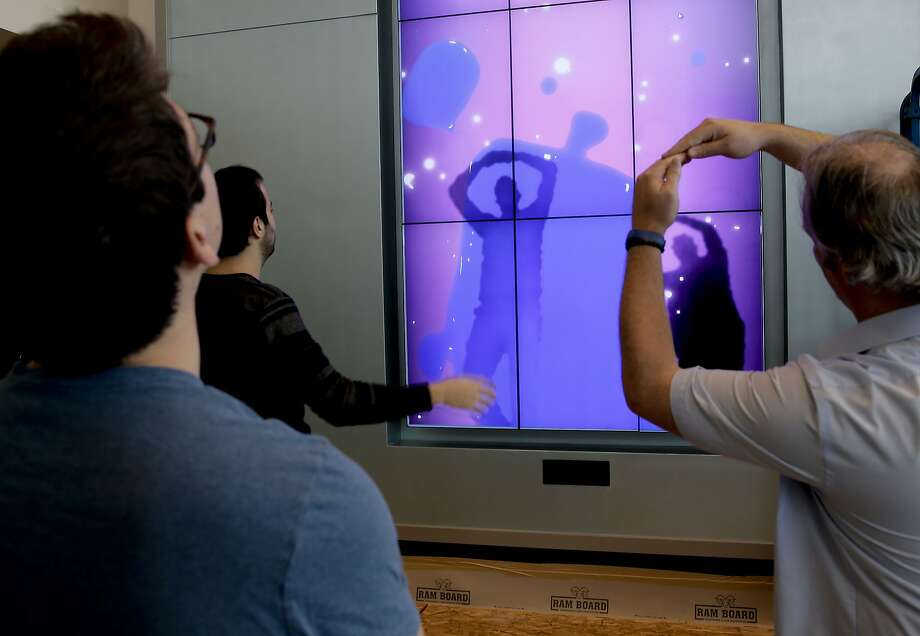 (l to r) Dogan Demir, Metin Nacar, and Cliff Meuller, with Kinesis Studio, test out their motion tracking interactive welcome wall that greets visitors to the pediatric department as the UCSF Medical Center  at Mission Bay which is preparing to officially open on Feb. 1, 2015 after more than decade as seen on Tuesday January, 27, 2015, in San Francisco, Ca. Photo: Michael Macor, The Chronicle