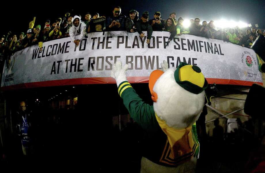Changed the game: The College Football PlayoffFinally! We can all agree that was more exciting, right? Next step: eight teams in. (Pictured: The Duck greeting fans at the Rose Bowl after a thrilling National Playoff Semifinal on Jan. 1, 2015.) Photo: Harry How, Getty Images / 2015 Getty Images