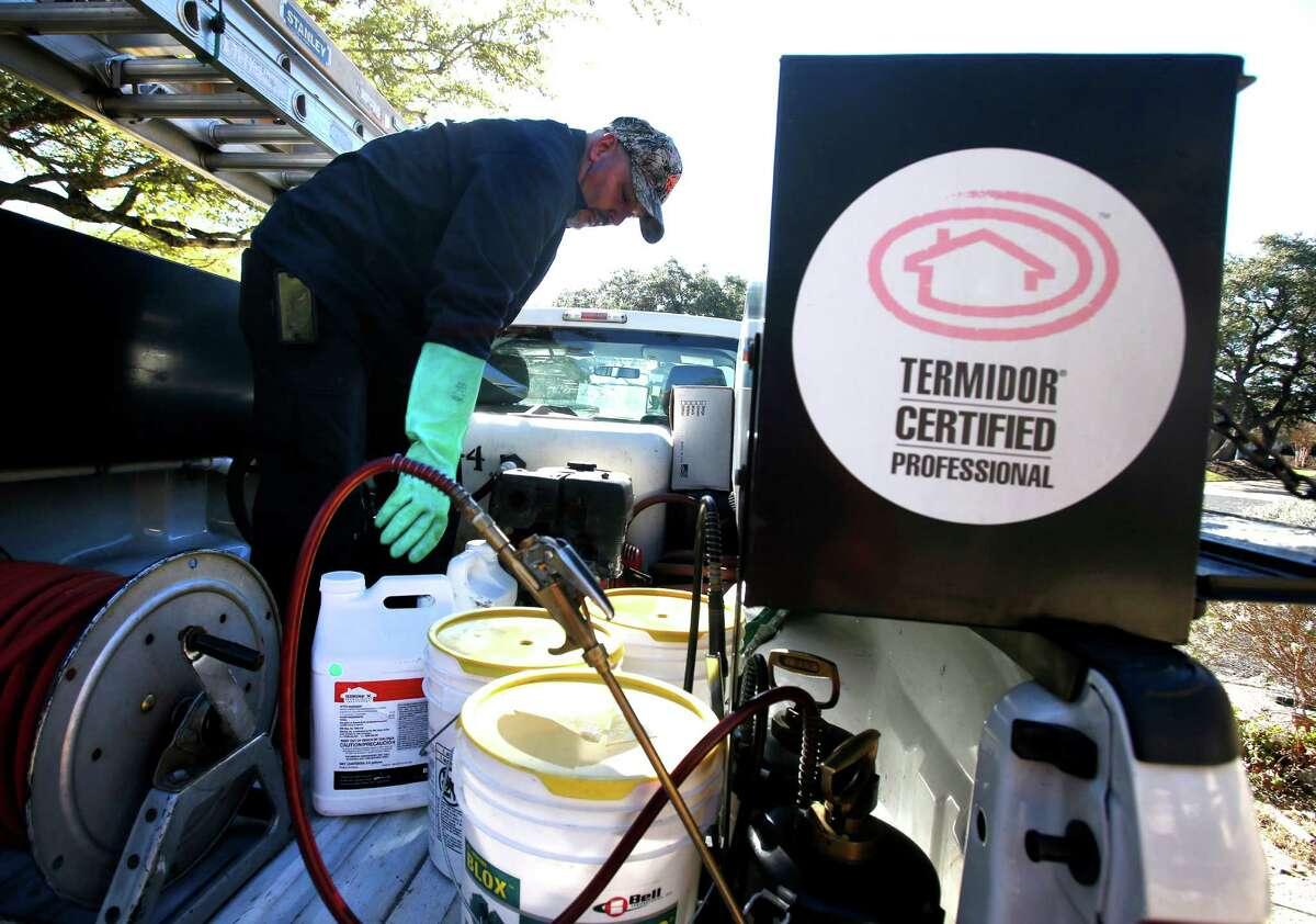 Randy Barnes, a termite certified pest technician with Bob Jenkins Pest & Lawn Services demonstrates the termite treatment process Tuesday, Jan. 27, 2015 at a far north side home. Authorities say late February through May is when termites most frequently surface, sometimes called swarming, in Central Texas.