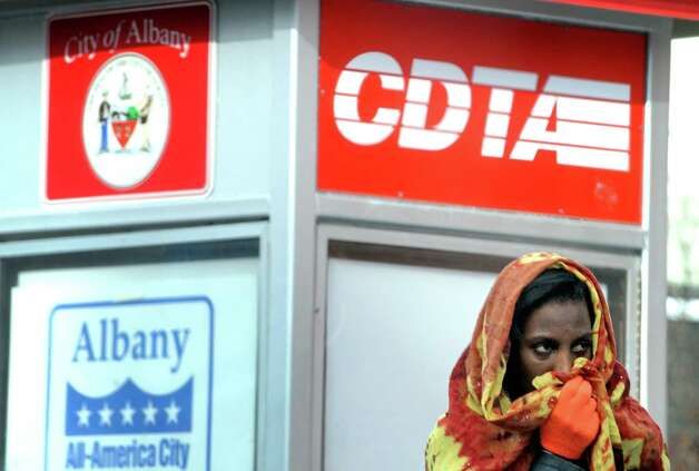 A women keeps coverd by a scarf while waiting for a bus at Wasington Avenue and Lark Street on Thursday Jan. 29, 2015 in Albany , N.Y. (Michael P. Farrell/Times Union) Photo: Michael P. Farrell