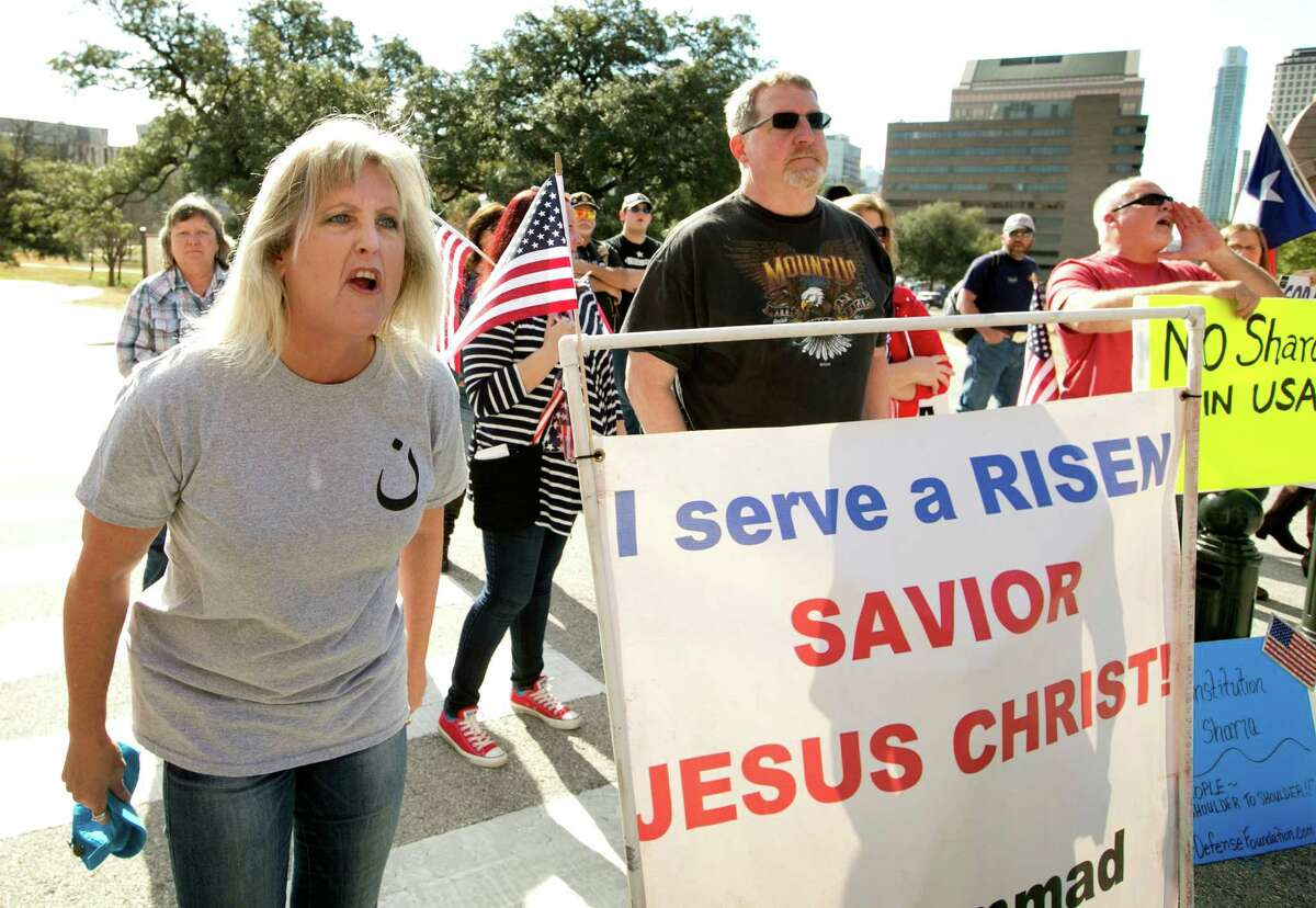 Protester Christine Weick yells at Muslims during the Texas Muslim Capitol Day in Austin, Texas, on Thursday, Jan. 29, 2015. Hundreds of Muslims from around Texas gathered for the Council on American-Islamic Relations rally and to talk to their representatives about legislation that's important to them. (AP Photo/Austin American-Statesman, Jay Janner) AUSTIN CHRONICLE OUT, COMMUNITY IMPACT OUT, INTERNET AND TV MUST CREDIT PHOTOGRAPHER AND STATESMAN.COM, MAGS OUT