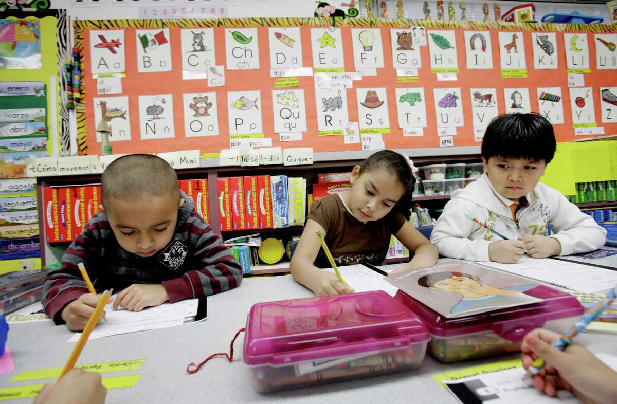 In 2011, kindergarden students Gael Alvarado, left, Perla Ortiz, center, and Yahir Perez do school work in a bilingual English-Spanish class at Hanby Elementary School in Mesquite, Texas. Funding for English language learners is also part of the lawsuit on Texas school financing generally. It is inadequate.