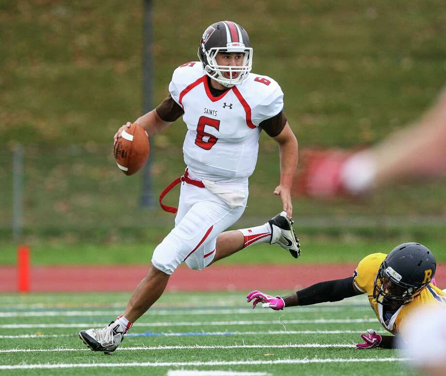 After starring at Greenwich High, QB Mike Lefflbine (6) is putting up big numbers for St. Lawrence. Photo: Christopher Cecere/RochesterCCPh, Christopher Cecere / Greenwich Time