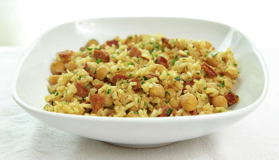 Brown rice, shown here with chickpeas and chorizo, is a nutritious, gluten-free whole grain.  Photo: ELY, Washington Post / THE WASHINGTON POST