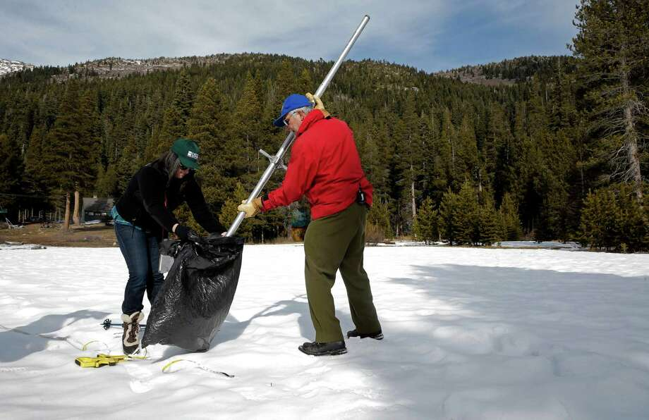 Frank Gehrke, the state's chief of snow surveys (right), collects snow samples with help from Michelle Stern a hydrologic technician with the USGS during the monthly snow survey at Phillips Station. Photo: Michael Macor / The Chronicle / ONLINE_YES