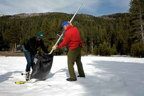 Frank Gehrke, the state's chief of snow surveys (right), collects snow samples with help from Michelle Stern a hydrologic technician with the USGS during the monthly snow survey at Phillips Station.
