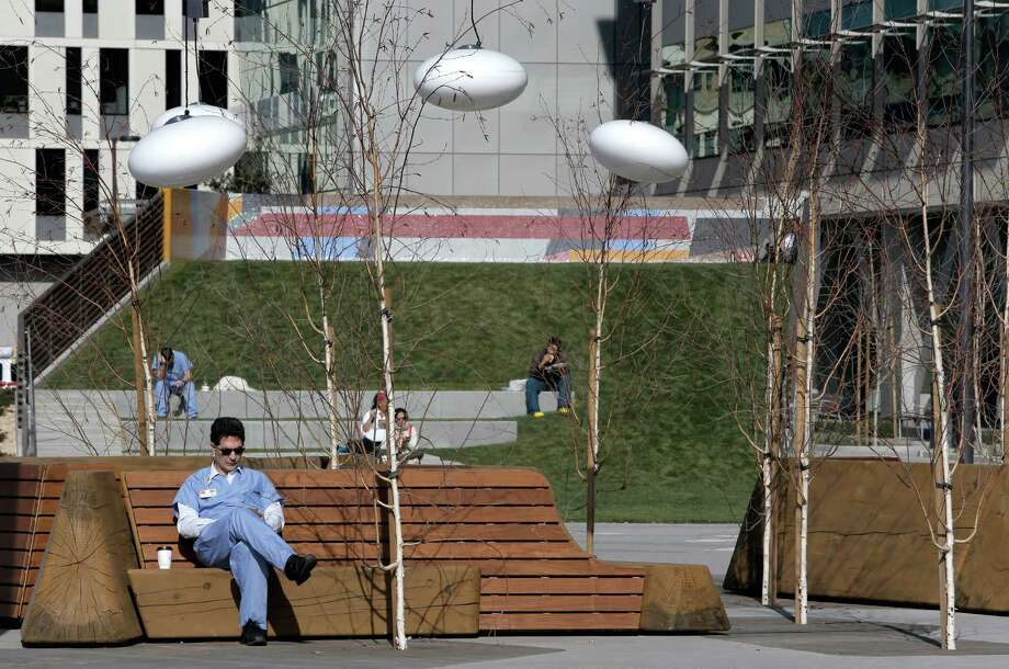 The UCSF Medical Center at Mission Bay, on Third Street between 16th and Mariposa, includes a linear public plaza. Photo: Michael Macor / The Chronicle / ONLINE_YES