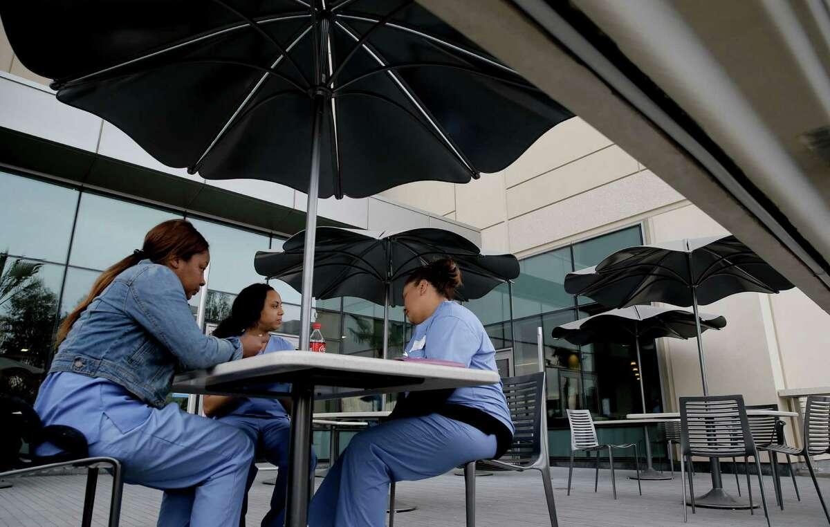 Aaronae Smith (left), E. O'Neal and Erica Rodriquez at the Betty Irene Moore Women's Hospital and Bakar Cancer center building at UCSF Medical Center at Mission Bay in San Francisco Ca., which is preparing to open on Feb. 1, 2015 after more than decade as seen on Tuesday January, 27, 2015.