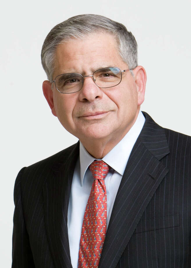 As his company reports a fourth-quarter loss, Occidental Petroleum CEO Stephen Chazen says oil field services companies are still charging too much when oil prices have fallen by half. (Occidental Petroleum) Photo: Copyright Eric Myer Photography