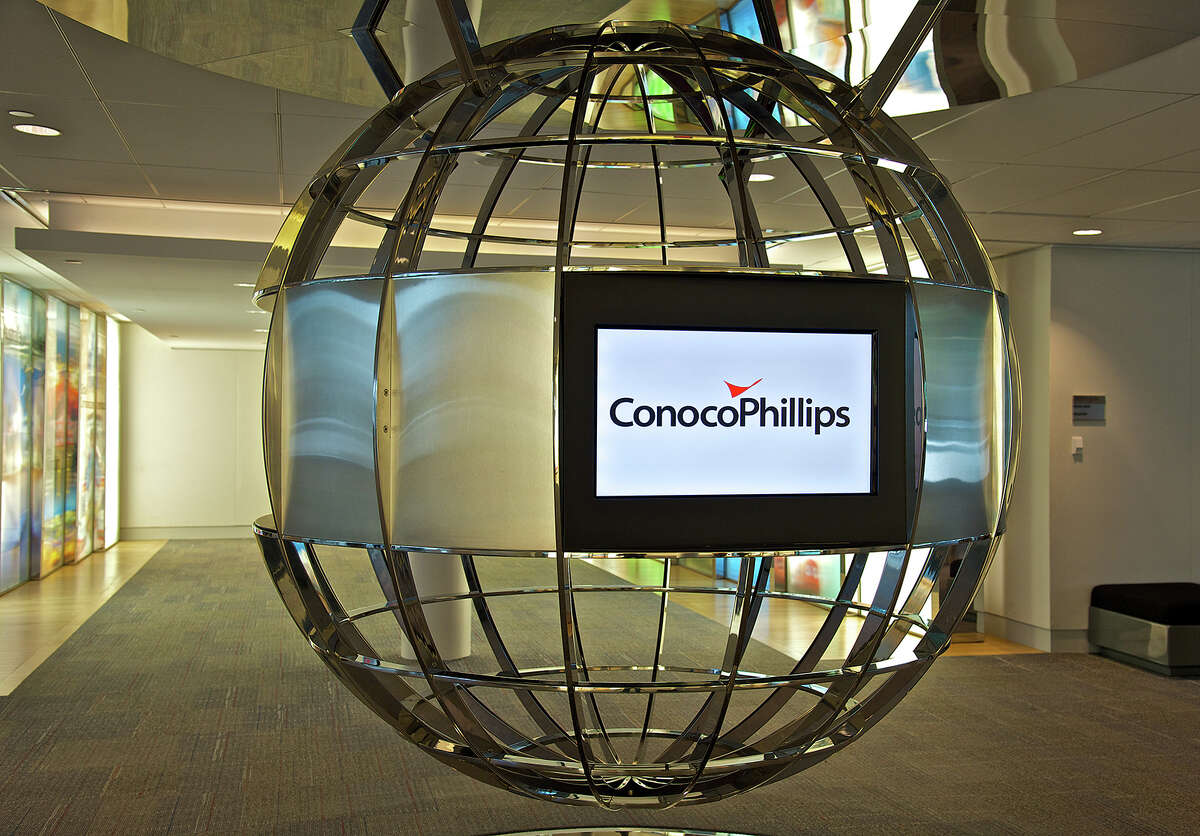 A stylized globe is the centerpiece at the West Houston headquarters of ConocoPhillips, which said Tuesday it is laying off 1,800 employees and 1,000 contractors comopanywide. (ConocoPhillips photo)