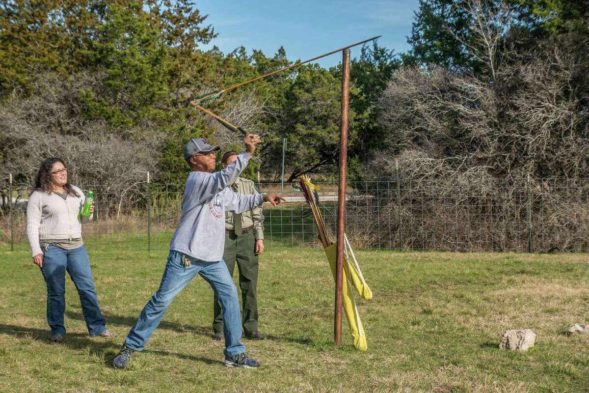 Rodney Franklin of Waco launches a spear using an atlatl during a program at McKinney Falls State Park. Photo by Joshua Trudell/For the Express-News