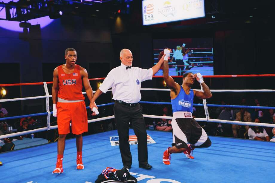 Stamfordís Chordale Booker (blue) is now the USA Boxing Elite Men Division 165-pound National Champion after winning beating two-time champion LaShawn Rodriguez this weekend in Spokane, Wash. Photo: Contributed Photo, Theresa Farnsworth/USA Boxing / Stamford Advocate Contributed
