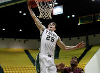 William & Mary' Terry Tarpey goes up for a layup.