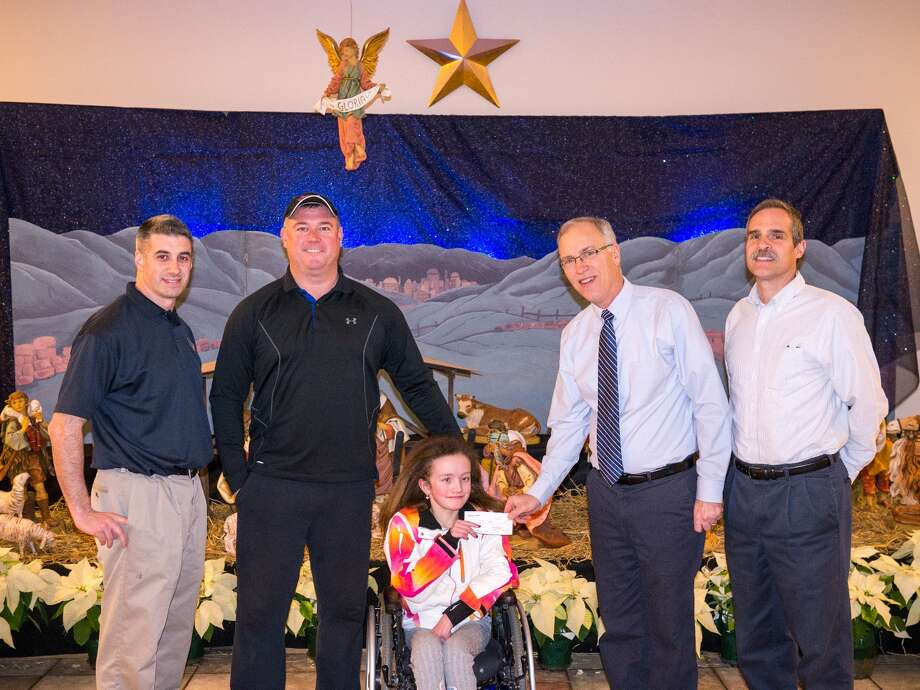 The Knights of Columbus Council #11064 in Clifton Park presents a check for $900 to Hannah?s Hope Fund after a recent pancake breakfast. Pictured, from left, are Grand Knight Chris Caputo, Matt Sames (Hannah?s father), Hannah Sames, along with Knights Tom Halabuda and Ray Gamino. The Hannah?s Hope Fund for Giant Axonal Neuropathy is a Clifton Park based charity dedicated to eradicating the disease. Over the past three years, Council #11064 has held pancake breakfasts in support of Hannah?s Hope and has donated $5,541 and more than 500 hours to the charity.
