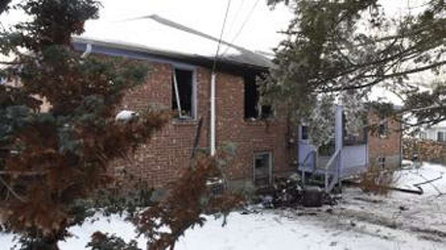 The rear of 156 Fairlawn Ave., in Albany where a woman died in a house fire on Wednesday, Jan. 28, 2015. Firefighters have not released the cause of the fire that began Wednesday evening at 156 Fairlawn Ave. (Skip Dickstein / Times Union)