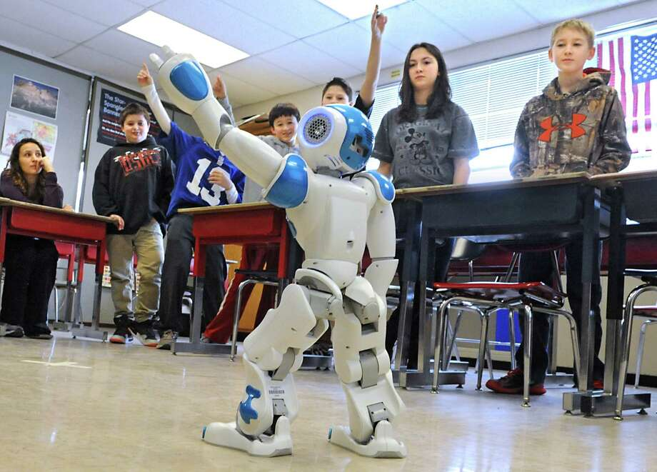 Seventh grade students watch Ricky the NAU robot perform a disco maneuver in a robotics workshop during STEM day at Maple Hill Middle School on Thursday, Jan. 29, 2015 in Castleton-on-Hudson, N.Y. Students in grades 5-8 learn about careers in Science, Technology, Engineering and Math through a day of engaging workshops led by business representatives, college students and classroom teachers. (Lori Van Buren / Times Union) Photo: Lori Van Buren / 00030360A