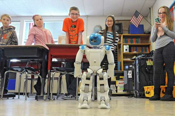 Seventh grade students watch Ricky the NAU robot perform some maneuvers in a robotics workshop during STEM day at Maple Hill Middle School on Thursday, Jan. 29, 2015 in Castleton-on-Hudson, N.Y. Students in grades 5-8 learn about careers in Science, Technology, Engineering and Math through a day of engaging workshops led by business representatives, college students and classroom teachers. (Lori Van Buren / Times Union)
