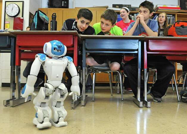 Seventh grade students watch Ricky the NAU robot perform some maneuvers in a robotics workshop during STEM day at Maple Hill Middle School on Thursday, Jan. 29, 2015 in Castleton-on-Hudson, N.Y. Students in grades 5-8 learn about careers in Science, Technology, Engineering and Math through a day of engaging workshops led by business representatives, college students and classroom teachers. (Lori Van Buren / Times Union) Photo: Lori Van Buren / 00030360A